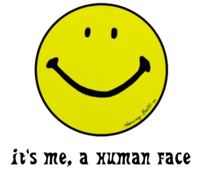 "Image of a smiley face above the text ""It's me, a human face"""